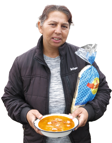Thankful lady holding soup and bread